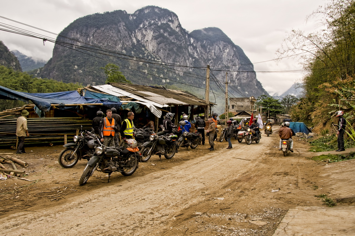 Ural on the Ho Chi Minh Trail - Coffee stop in a small village on the Ma River