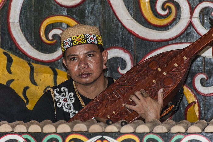 Dayak musician at Pampang Cultural Tourism Village